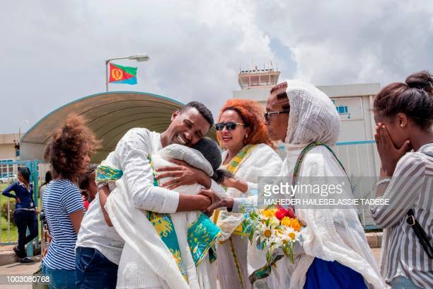 Medhane Berhane cries while meeting his mother and family at the Asmara International airport July 21 2018 when he sets foot in the Eritrean capital...