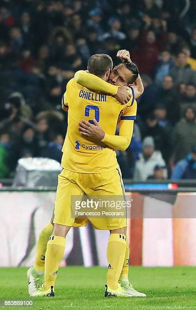 Medhi Benatia and Giorgio Chiellini players of Juventus celebrate the victory after the Serie A match between SSC Napoli and Juventus at Stadio San...
