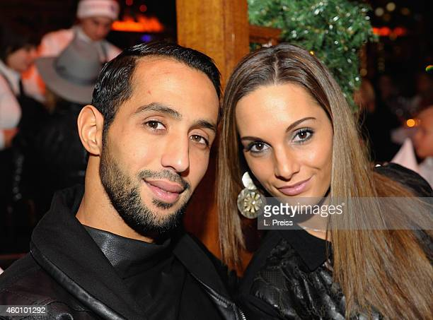 Medhi Benatia and his wife Cecile Benatia attend the FC Bayern Muenchen Christmas Party at Schubeck's Teatro restaurant on December 7 2014 in Munich...