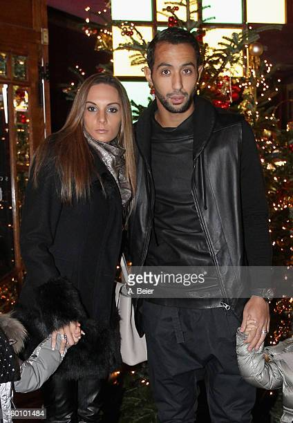 Medhi Benatia and his wife Cecile Benatia attend the FC Bayern Muenchen Christmas Party at Schuhbeck's Teatro restaurant on December 7 2014 in Munich...