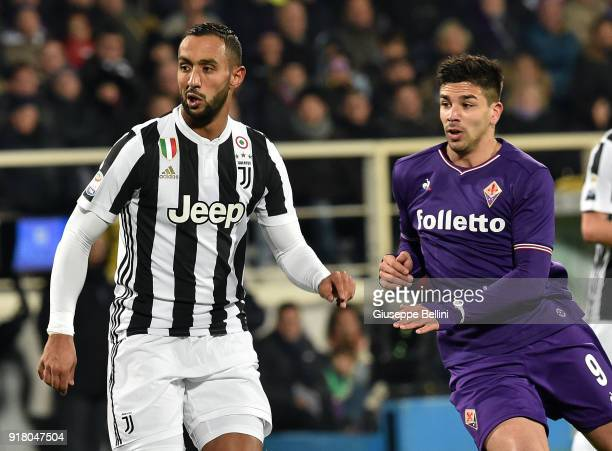 Medhi Benatia of Juventus and Giovanni Simeone of ACF Fiorentina in action during the serie A match between ACF Fiorentina and Juventus at Stadio...