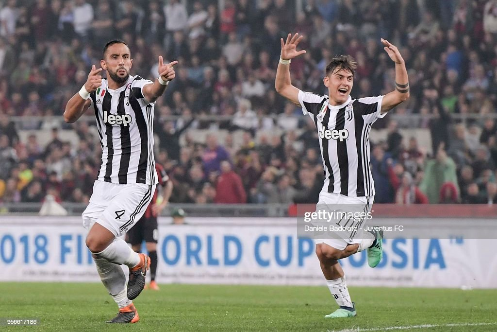 Medhi Benatia of Juventus celebrates his goal of 1-0 with teammate Paulo Dybala during the TIM Cup Final between Juventus and AC Milan at Stadio Olimpico on May 9, 2018 in Rome, Italy.