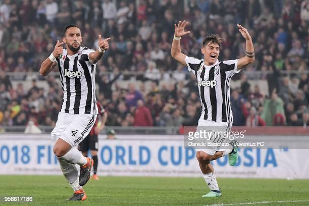 Medhi Benatia of Juventus celebrates his goal of 10 with teammate Paulo Dybala during the TIM Cup Final between Juventus and AC Milan at Stadio...