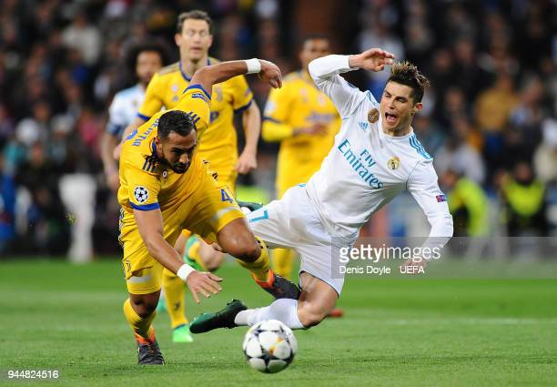 Medhi Benatia of Juventus challenges Cristiano Ronaldo of Real Madrid during the UEFA Champions League Quarter Final Second Leg match between Real...