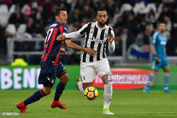 Medhi Benatia of Juventus competes for the ball with Ante Budimir of Crotone during the Serie A match between Juventus and FC Crotone at Allianz...