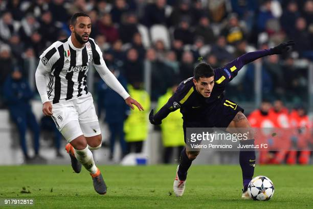 Medhi Benatia of Juventus competes for the ball with Erik Lamela of Tottenham Hotspur FC during the UEFA Champions League Round of 16 First Leg match...