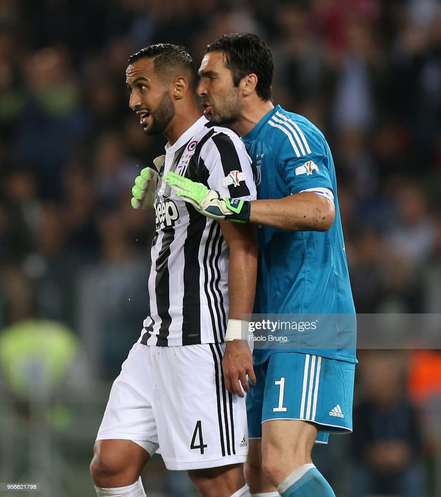 Medhi Benatia with his teammate Gianluigi Buffon of Juventus celebrates after scoring the team's third goal during the TIM Cup Final between Juventus and AC Milan at Stadio Olimpico on May 9, 2018 in Rome, Italy.
