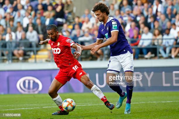 Medhi Carcela midfielder of Standard Liege and Philippe Sandler defender of Anderlecht during the Jupiler Pro League match between RSC Anderlecht and...