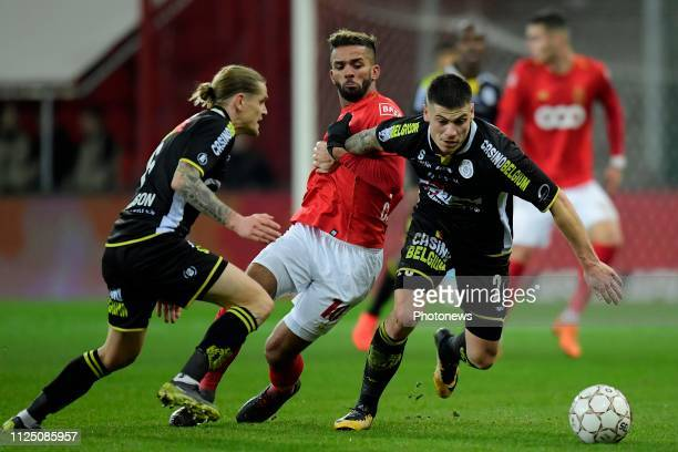 Medhi Carcela midfielder of Standard Liege is fighting for the ball with Ari Skulason defender of Lokeren and Mickael Tirpan defender of Lokeren...