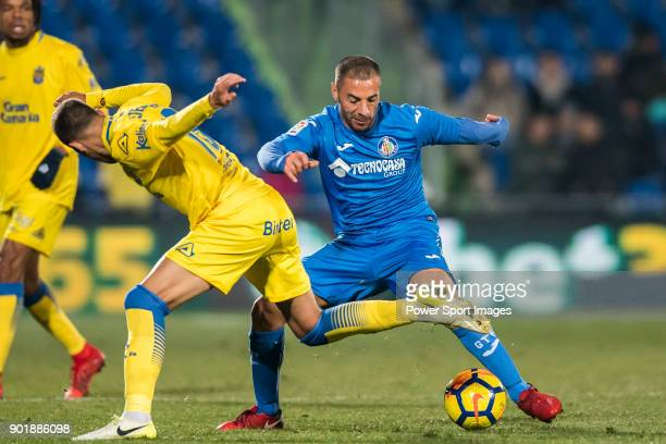 Medhi Gregory Guiseppe Lacen of Getafe CF fights for the ball with Javi Castellano Betancor of UD Las Palmas during the La Liga 201718 match between...