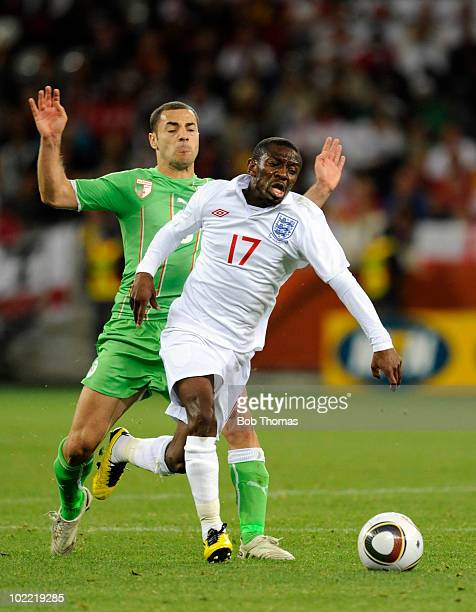Medhi Lacen of Algeria challenges Shaun WrightPhillips of England during the 2010 FIFA World Cup South Africa Group C match between England and...