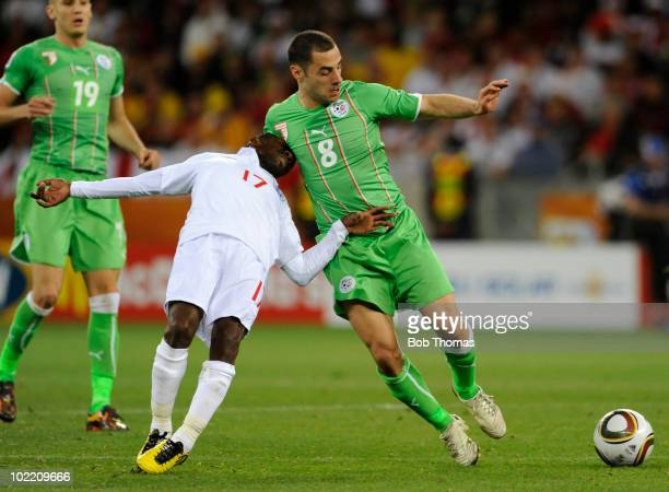 Medhi Lacen of Algeria traps the head of Shaun WrightPhillips of England during the 2010 FIFA World Cup South Africa Group C match between England...