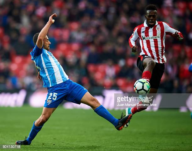 Medhi Lacen of Malaga CF competes for the ball with Inaki Williams of Athletic Club during the La Liga match between Athletic Club Bilbao and Malaga...