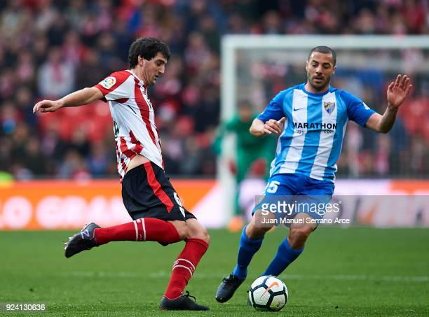 Medhi Lacen of Malaga CF competes for the ball with Mikel San Jose of Athletic Club during the La Liga match between Athletic Club Bilbao and Malaga...