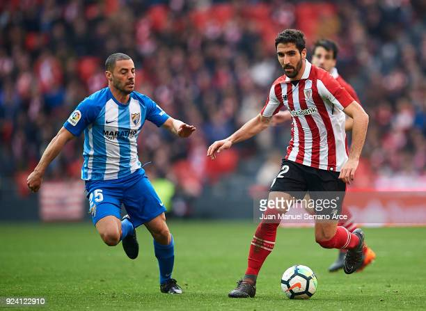 Medhi Lacen of Malaga CF competes for the ball with Raul Garcia of Athletic Club during the La Liga match between Athletic Club Bilbao and Malaga CF...