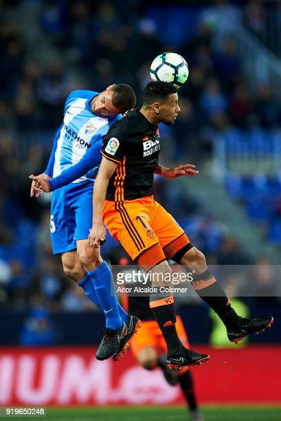 Medhi Lacen of Malaga duels for the ball with Francis Coquelin of of Valencia CF during the La Liga match between Malaga and Valencia at Estadio La...