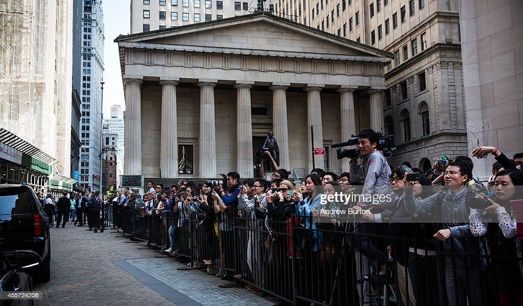 Media and fans of Alibaba Group wait outside the New York Stock Exchange while executives of the company leave the building after the company's initial public offering (IPO) on September 19, 2014 in New York City. The New York Times reported yesterday that Alibaba had raised $21.8 Billion in their initial public offering so far.