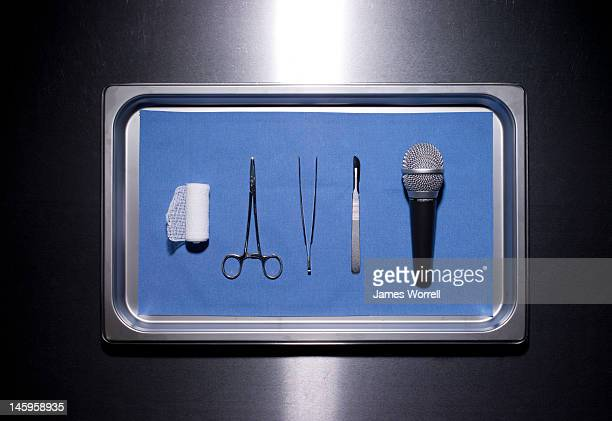 media and medicine - surgery tools stock photos and pictures