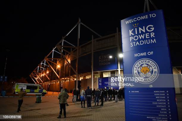 Media and members of the public are seen at a police cordon outside Leicester City Football Club's King Power Stadium in Leicester eastern England on...