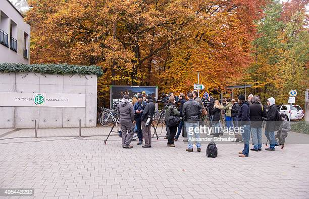 Media and press wait in front of the DFB building after german police raided the Frankfurt headquarters of the DFB Germany's football association on...
