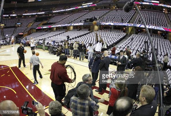 Media and security surrond LeBron James of the Miami Heat ...