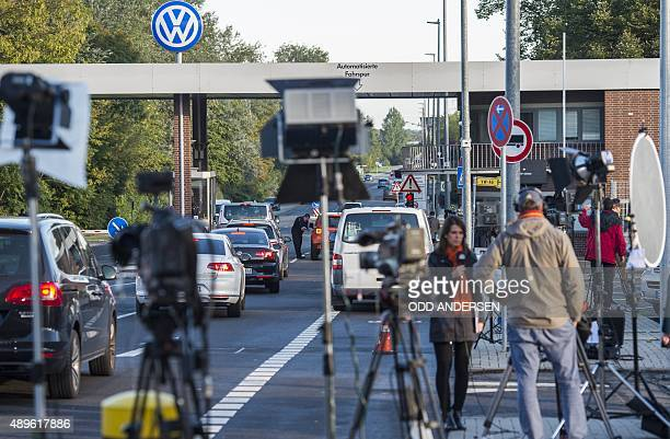 Media are seen waiting outside the main gate of the headquarters of German car maker Volkswagen in Wolfsburg central Germany on September 23 2015...