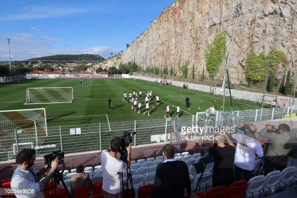 Media attend the first training session of Monaco's French coach Thierry Henry in La Turbie, near Monaco on October 18, 2018. - The 41-year-old...