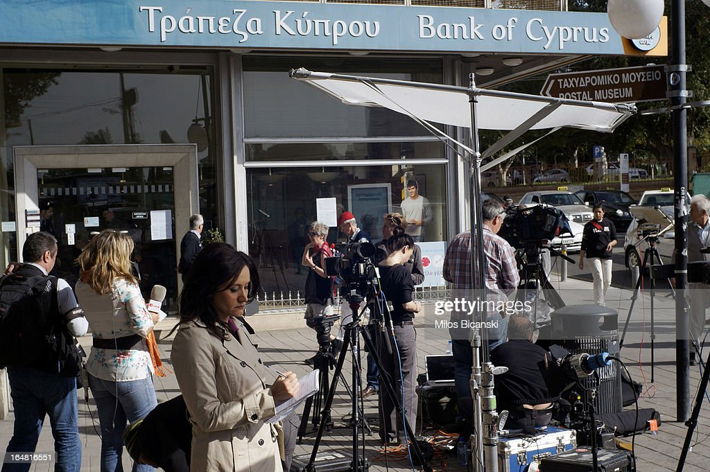 Media await vainly a run on a branch of Bank of Cyprus as the country's banks re-open following 12 days of closure on March 28, 2013 in Nicosia, Cyprus. Bank trading began again after the government negotiated a EUR 10bn (GBP 8.4bn) bailout package. Captial controls are limiting withdrawals to EUR 300 perday and the Cyprus stock exchange remains closed.