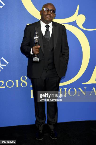 Media award winner Edward Enninful poses with award at the 2018 CFDA Fashion Awards at Brooklyn Museum on June 4 2018 in New York City