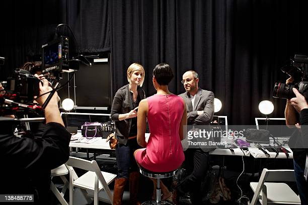 media backstage with fashion designer and model - backstage stock pictures, royalty-free photos & images