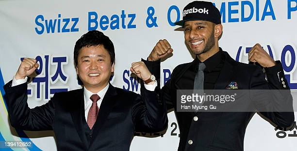 O media CEO Kim JungWoong and leading singer and producer Swizz Beatz from USA poses for media after a press conference to announce his business...