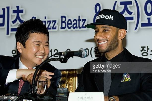 O media CEO Kim JungWoong and leading singer and producer Swizz Beatz from USA poses for media a press conference to announce his business alignment...