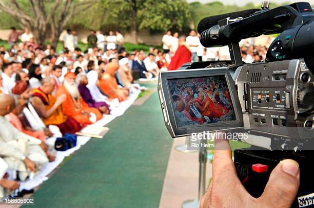 Media coverage of the Dalai Lama at an interfaith prayer meeting for those killed in Tibet in recent riots and for peace in the region at the Gandhi...