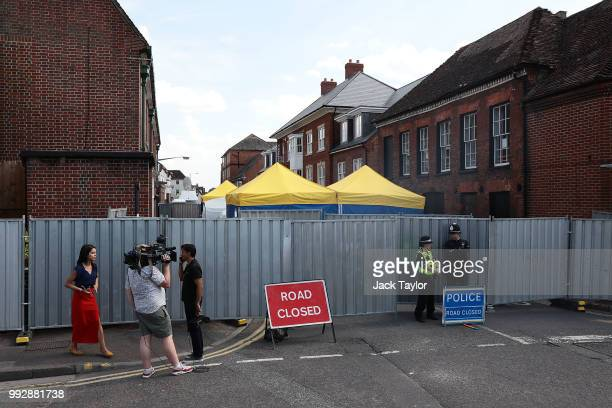 A media crew stand outside a police cordon in front of John Baker House Sanctuary Supported Living after a major incident was declared when a man and...
