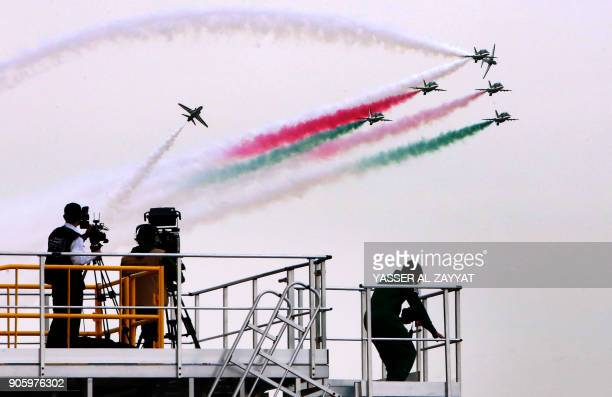 A media crew works as Saudi falcon Hawk Mk 65 aircrafts perform during the Kuwait aviation show in Kuwait City on January 17 2018 / AFP PHOTO /...