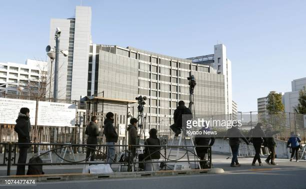 Media crews gather on Dec 21 in front of the Tokyo detention center where Nissan Motor Co's longserving boss Carlos Ghosn is being held in custody...