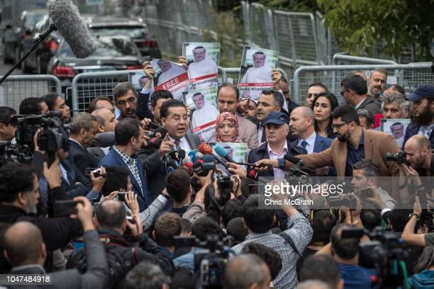 Media crowd around as people hold posters of Saudi journalist Jamal Khashoggi during a protest organized by members of the TurkishArabic Media...