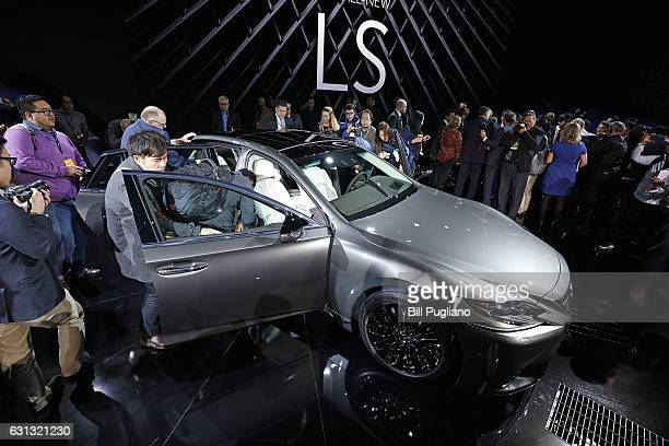 Media examine the 2018 Lexus LS Sedan at its reveal at the 2017 North American International Auto Show on January 9 2017 in Detroit Michigan...