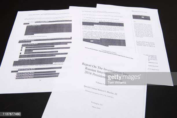 Media films a few pages of special counsel Robert Mueller's report on Russian interference in the 2016 election which was printed out by staff in the...