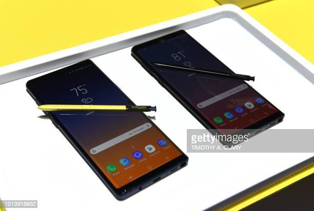 Media gather around as Samsung unveils the Galaxy Note 9 during an Unpacked event at the Barclays Center in the New York City borough of Brooklyn...