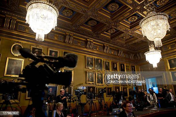 Media gather before the announcement by members of the Swedish Royal Academy of Sciences in Stockholm on October 4 2011 that US Saul Perlmutter and...