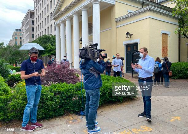 Media gather in front of Saint Johns Episcopal Church and Lafayette Square near the White House on June 2 2020 in WashingtonDC after US President...