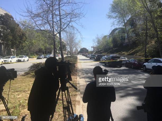 Media gather outside during an active shooting at YouTube's offices in San Bruno California on April 3 2018 Gunshots erupted at YouTube's offices in...