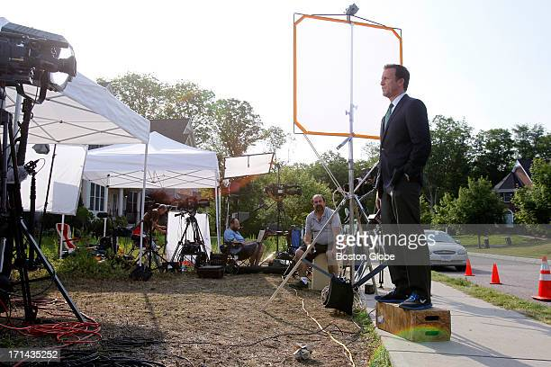 Media gather outside of New England Patriots Aaron Hernandez's home in North Attleborough Mass June 23 2013 Hernandez has been linked to the ongoing...