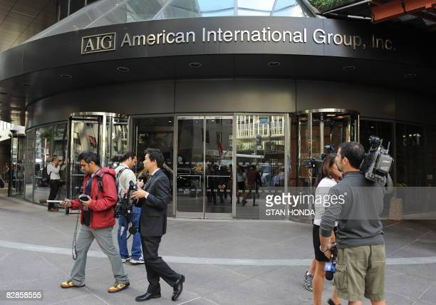 Media gather outside the offices of of troubled insurer American International Group Inc September 17 2008 in the lower Manhattan area of New York...