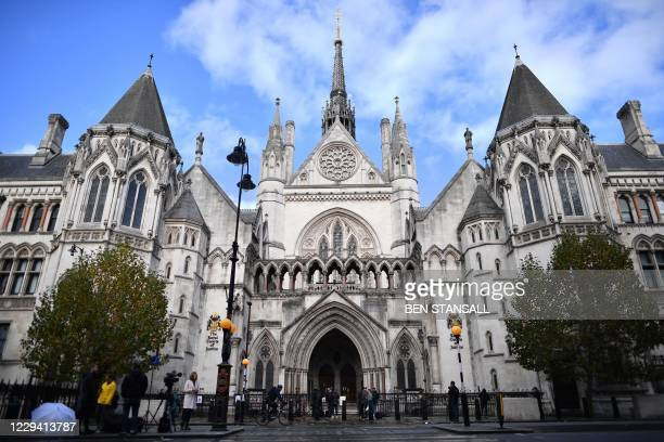 Media gather outside the Royal Courts of Justice where the High Court is located in London on November 2, 2020. - Hollywood star Johnny Depp on...