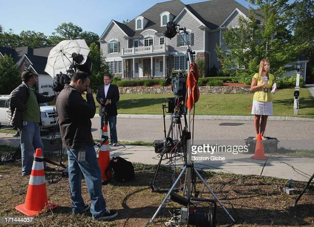 Media gathered outside the home of New England Patriots player Aaron Hernandez in North Attleborough Mass Friday June 21 2013 Hernandez has been...