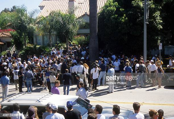 Media gathers at the Brentwood condo where Nicole Brown Simpson and Ron Goldman were stabbed to death a day earlier on June 13, 1994 in Brentwood,...