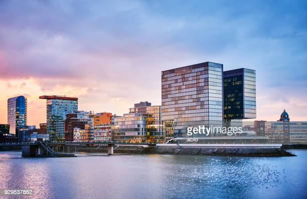 media harbour duesseldorf at dusk - düsseldorf stock pictures, royalty-free photos & images