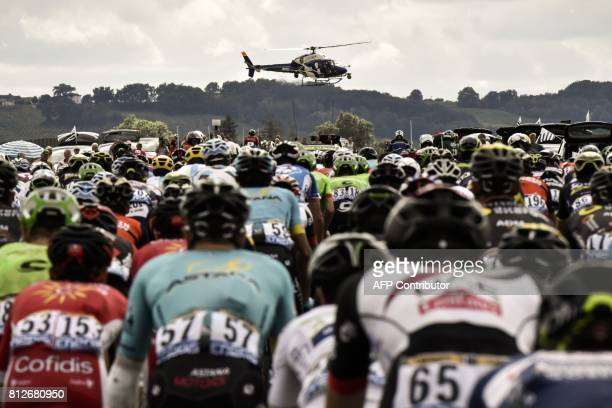 TOPSHOT A media helicopter flies over the pack riding during the 178 km tenth stage of the 104th edition of the Tour de France cycling race on July...